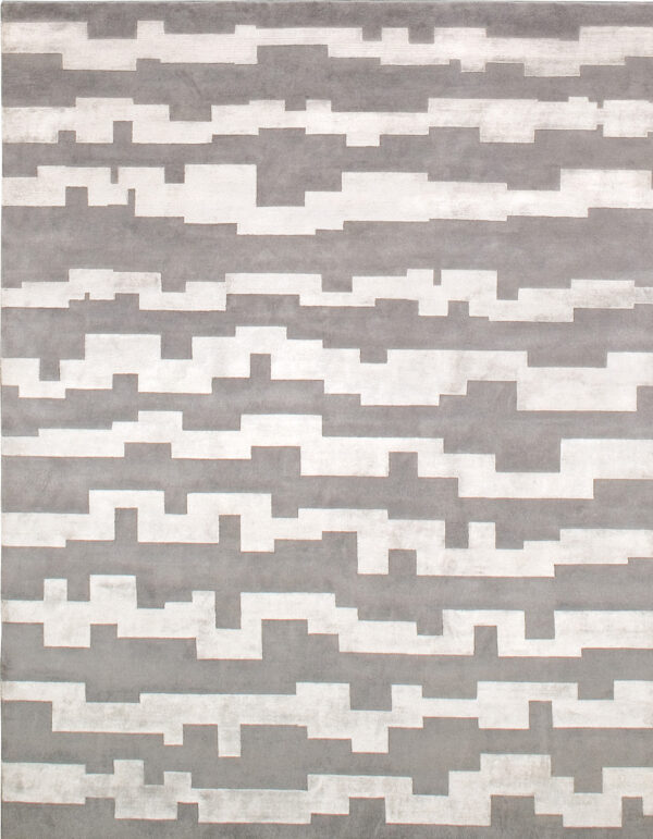 Gray carpet made in wool and silk whose design is made of stripes of irregular shape